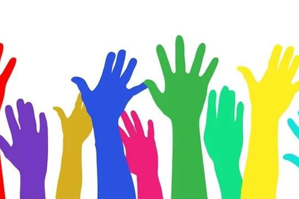 Rainbow coloured hands rising into the air